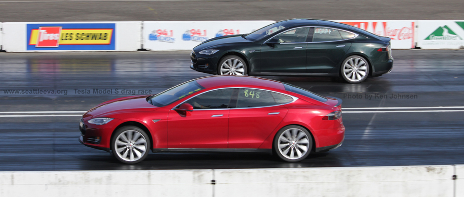 Image of a red Tesla Model S at the race track