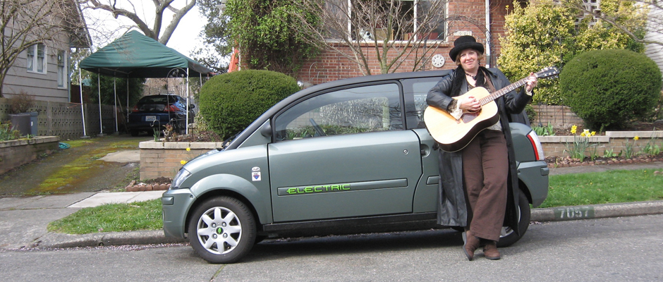 Image of  musician Deb Seymour with her 2008 ZENN electric car